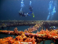 Divers at decommissioned Oil Rig made to artificial reefs. by Ng Steven 